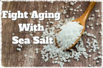 Sea salt over wooden background