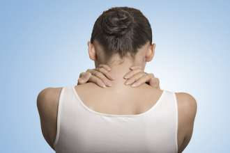 back view tired female massaging her painful neck