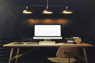 Mock up of generic design computer screen. Workspace in the black loft with vintage tiles on the wall. 3D rendering