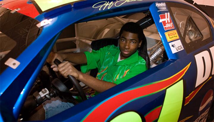 Allan, age 17, sits behind the wheel of NASCAR champion Jeff Gordon's #24 DuPont Chevy Monte Carlo race car. (Photo Courtesy Make-A-Wish)