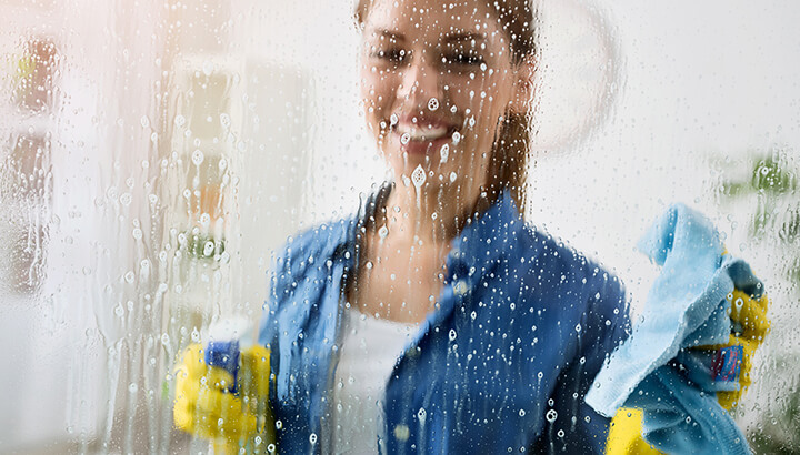 Homemade window washing spray with vinegar and Castile soap is as effective as Windex.