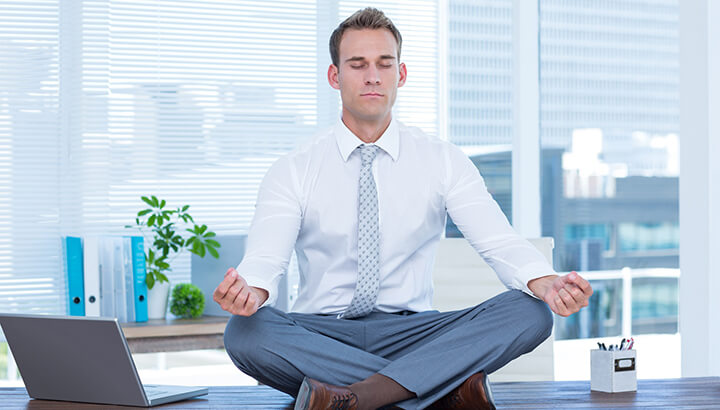 Doing yoga at your desk can keep you calm and happy.