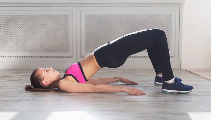 Targeting your glutes with a bridge pose can define your butt